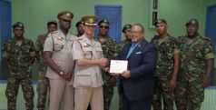 Commanding officer of the Regiment's First Engineering Battalion Major Jerome Affonso, receives an appreciation award on behalf of soldiers who worked alongside volunteers on the Moriah project from chairman of the board of directors of Habitat for Humanity Trinidad and Tobago Derwin Howell.